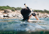 view of Woman snorkeling with old turret bunker second war in Sardinia - italy. - 220981222