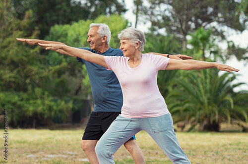 Leinwanddruck Bild Old man and woman doing stretching exercise