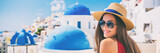 Summer travel tourist girl smiling on Santorini Europe holiday. Vacation panoramic banner landscape on the three blue domes.