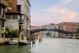 Venice, Italy,  Grand canal. The Grand canal is the most famous Venetian canal that runs through the city. - 220998010