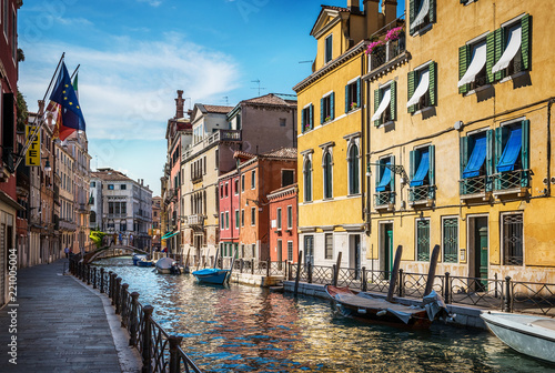 Traditional canal street and colorful Venetian houses in Venice, Italy. - 221005004