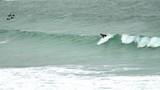 Surfer  riding a wave - 221024467