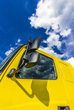 Cumulus clouds over the cab of the truck - 221028662