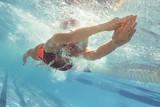 Professional swim athlete gliding in pool - 221034091