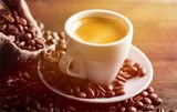 Cup of Coffee and Coffee Beans - 221045843