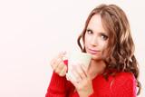 Autumn woman holds mug with coffee warm beverage - 221046805