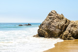 Rocks in the ocean on a sunny day at Broad Beach in Malibu, California. - 221058683