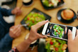 Leinwandbild Motiv Photo On Phone. Closeup Woman Hands Photographing Food