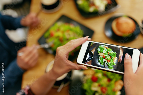 Photo On Phone. Closeup Woman Hands Photographing Food - 221075658