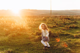 Portrait of a cute beatiful and happy girl running through the sunny field - 221076032