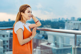 Breathtaking view. Nice joyful woman smiling while looking over the city - 221078867