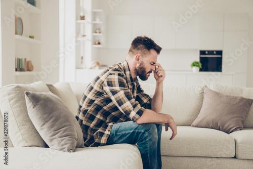 Leinwanddruck Bild Side view photo of pensive man in stylish brown checkered shirt
