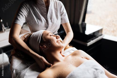 Leinwanddruck Bild Beautiful woman enjoying massage