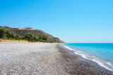Empty pebble beach on the Mediterranean coast in Cyprus in sunny summer day - 221083410