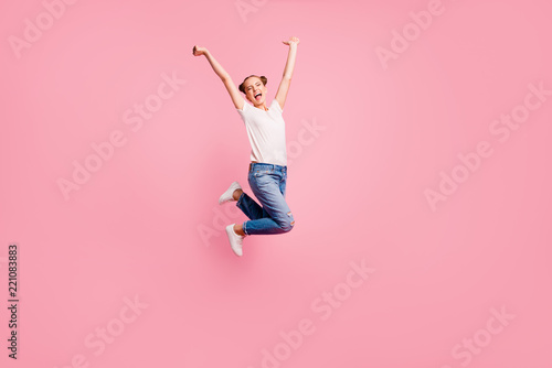Leinwanddruck Bild Full length size body studio photo portrait of cheerful glad rejoicing pretty nice charming cute lovely sweet girl jumping up isolated on pastel pink background