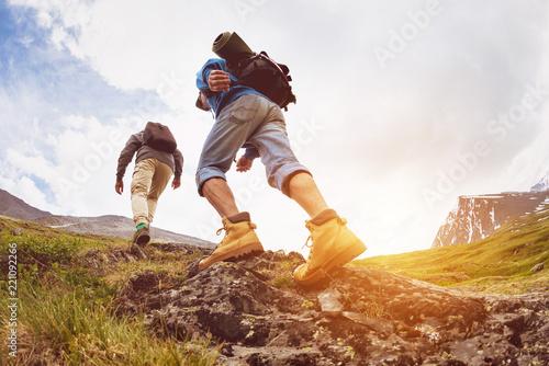 Leinwandbild Motiv Trekking concept two tourists walking mountains