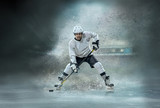 Caucasian ice hockey Players in dynamic action in a professional - 221092824