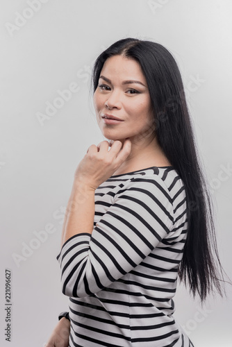 Long Hair Dark Eyed Woman With Long Straight Hair Standing In Front