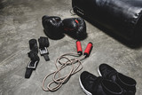 various boxing equipment lying on concrete surface - 221098496