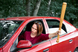 young female driver has stress and anger, threatens with a baseball bat, has a red car - 221099035