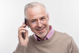 Happy man. Image without face retouching with handsome bearded senior man feeling happy while having phone conversation - 221100486