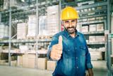 smiling handyman in warehouse