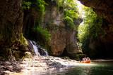 Martvili, Georgia - June 22 2018: People in boat and waterfall in Martvili Canyon