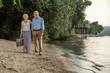 Leinwanddruck Bild - Walks and talks by the river