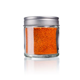 piment d´espelet in a glas with metal lid, isolated on white - 221125043
