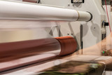 Big printing laminator armed with glossy paper rolls and transparent film. - 221125816