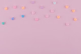 Pastel heart pattern on pink background with copy space