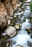 Rapid flowing water in the river. - 221135436