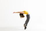 Hip Hop Dancer Doing Backbend While Standing On Tiptoes