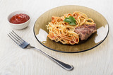 Spaghetti with ketchup, beef stew, fork, bowl with ketchup