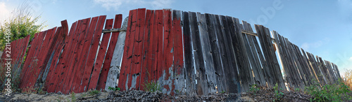 Foto Murales panorama of an old wood red fence