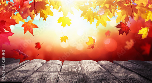 Autumn Colorful Background With Leaves And a Wooden Table In Sunlight © Maksim Pasko