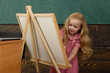 Little child learn drawing on studio easel. I like drawing