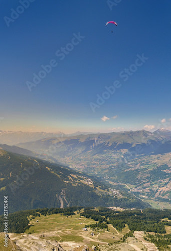 Foto Murales aerial view on alpine valley with a paragli