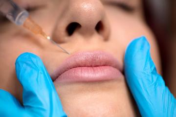 Woman having Botox treatment in beauty salon