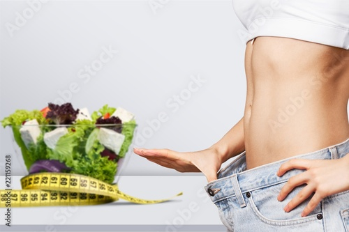 Wall mural Young fit woman, weight loss concept