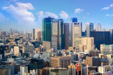 cityscape of tokyo city skyline in Aerial view with skyscraper, modern business office building with blue sky background in Tokyo metropolis city, Japan.
