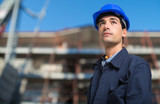 Closeup of an engineer in hardhat - 221169650