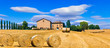 Quadro Beautiful countryside landscape with hay rolls and farm houses in Tuscany. Italy