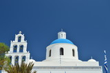 Beautiful View Of The Bell Tower And Roof Of The Main Facade Of Panagia Church In Oia Santorini Island. Architecture, Landscapes, Travel, Cruises. July 7, 2018. Santorini Island, Thera. Greece. - 221173457