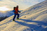 Ski with amazing view of swiss famous mountains in beautiful winter snow Mt Fort. The skituring, backcountry skiing in fresh powder snow. - 221175456