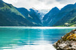 Oldevatnet lake in and view of Briksdal glacier in Norway