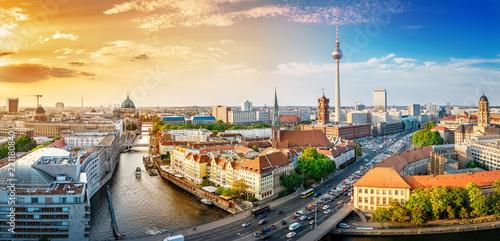 Leinwanddruck Bild panoramic view at the berlin city center at sunset
