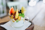 Healthy and fresh furit snack with greek yogurt in glass cup. - 221181405
