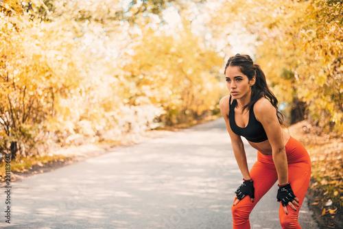 Fototapeta Fit female athlete on her morning run in the park.