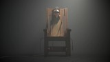 Old wooden electric chair in soft spotlight of a foggy room full of smoke. Camera slow pan movement. Shocking moment of death sentence realisation. Execution as a capital crime punishment. - 221188030